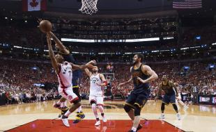 Toronto Raptors guard Kyle Lowry (7) gets fouled by Cleveland Cavaliers centre Tristan Thompson (13) during second half of the Eastern Conference final NBA playoff basketball action in Toronto on May 27, 2016. (THE CANADIAN PRESS/Nathan Denette)