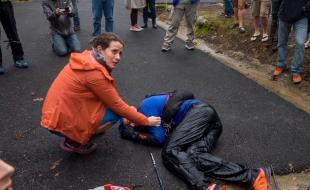 Gary Robbins, with his wife Linda Barton-Robbins by his side, collapses after finishing the 2017 Barkley Marathons. (Michael Doyle/Canadian Running Magazine)