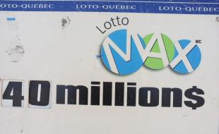 A Lotto-Quebec sign for a Lotto-Max draw in Montreal, Quebec. (The Canadian Press Images/Lee Brown)