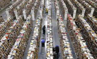 Employees stock shelves at an Amazon.com Fulfillment Centre. (AP Photo/Ross D. Franklin)