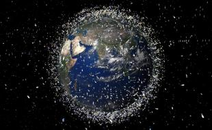 Space debris in orbit around the Earth. (Photo by REX/European Space Agency)