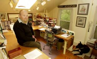 Author Farley Mowat in the room where he did most of his writing. It is on the second floor of a house that he owned near his main residence. Picture taken on October 31, 2002. (Photo by Tibor Kolley.)
