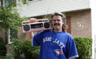 Blair McMillan shows off his pink ghetto blaster outside his home.