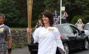The Olympic Torch for the 2012 Summer Olympics is carried through Onchan, Isle of Man on Day 15 of the relay.