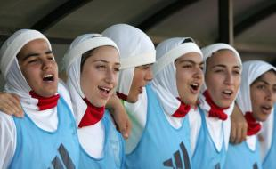 Member of the Iranian women's football team celebrate a win over Syria in 2007. (AP Photo/Mohammad abu Ghosh, File)