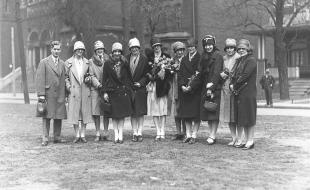 The Edmonton Commercial Graduates basketball team, arriving in Toronto on April 19, 1927 for the Canadian championship series with the Lakeside team. Third from left, Hattie Hopkins, substitute; Margaret MacBurney, star forward; Elsie Bennie, defense; Dorothy Johnson holding flowers, captain of the team; and world's champion foul-shooter; Mildred McCormack, substitute; Daisy Johnson, centre; Kate Macrae, defense; and Marguerite Bailey. (John Boyd/The Globe and Mail).