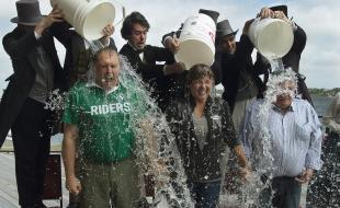 Yukon Premier Darrell Pasloski, B.C. Premier Christy Clark and Nunavut Premier Peter Taptuna, left to right, participate in the ALS Ice Bucket Challenge in Charlottetown, P.E.I. on August 29, 2014. (THE CANADIAN PRESS/Andrew Vaughan)