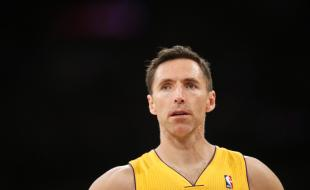 In this April 1, 2014 file photo, Los Angeles Lakers guard Steve Nash stands on the court against the Portland Trail Blazers during the first half of an NBA basketball game in Los Angeles. (AP Photo/Danny Moloshok, File)