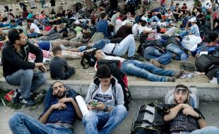 Syrian refugees sleep as they wait at the bus station in Istanbul, Turkey on September 15 en route to Germany.