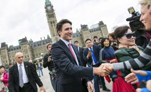 Canadian prime minister-designate Justin Trudeau greets people as he leaves Parliament Hill in Ottawa on October 20, 2015. EPA/Chris Roussakis