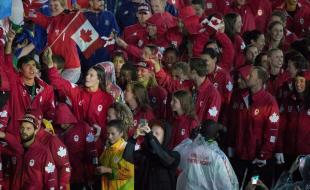 Penny Oleksiak carries a flag and walks with her teammates into the closing ceremonies of the Olympic Games in Rio de Janeiro, Brazil, on August 21, 2016. (THE CANADIAN PRESS/HO - COC - Jason Ransom)