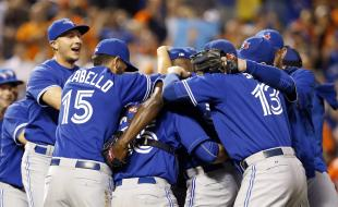 Members of the Toronto Blue Jays celebrate after winning the first baseball game of a doubleheader against the Baltimore Orioles on September 30, 2015, in Baltimore. Toronto won 15-2 to clinch the American League East. (AP Photo/Patrick Semansky.)