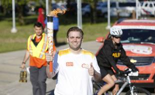 A torchbearer in Sault Ste. Marie on Day 4 of the 2015 Pan Am Games Torch Relay, a 41-day journey that began on May 30 to share the Pan Am spirit in more than 130 communities before the Games begin on July 10.