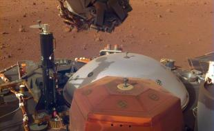 This image from InSight's robotic-arm mounted Instrument Deployment Camera shows the instruments on the spacecraft's deck, with the Martian surface of Elysium Planitia in the background. The image was received on December 4, 2018 (Sol 8). Credit: NASA/JPL-Caltech