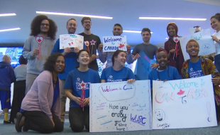 A group of students, including Tamasha Hussein (bottom right), welcomes Clemance Bisamu and other new refugee scholars to Vancouver. (Jon Hernandez via cbc.ca)