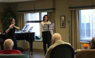 Ivy Manouchehri and Kristal Daniels performing for residents at Oakcrossing Retirement Home in London, Ontario. (Photo by Abby Plener via cbc.ca)